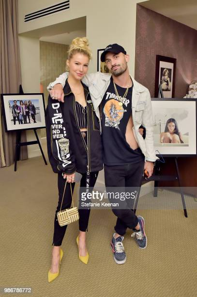 Lexi Atkins and guest attend Diesel Presents Scott Lipps Photography Exhibition 'Rocks Not Dead' at Sunset Tower on June 28 2018 in Los Angeles...
