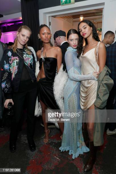 Lexi Boling Adesuwa Aighewi Iris Law and Jordan Daniels attend the LOVE Christmas Drinks at Bistrotheque on December 01 2019 in London England