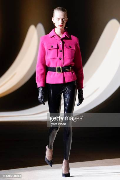 Lexi Boling walks the runway during the Saint Laurent show as part of the Paris Fashion Week Womenswear Fall/Winter 2020/2021 on February 25, 2020 in...