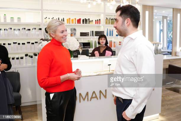 Lexi Cross and Roman Kusayev attend the Roman K Salon Madison Avenue Opening on November 21 2019 in New York City