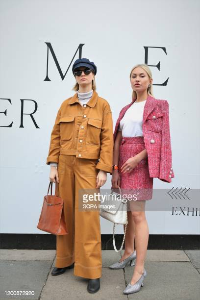 Lexi Fargo and Ava de la flor poses for a photo as they attend the London Fashion Week Womens Day One Fashion Show