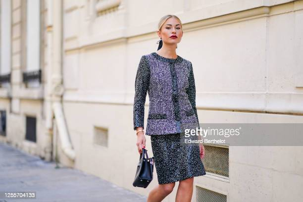 Lexi Fargo wears a green and white glittering shiny tweed Chanel jacket, a Chanel skirt, a Dior black leather bag, a hair bow/ribbon from Maison...