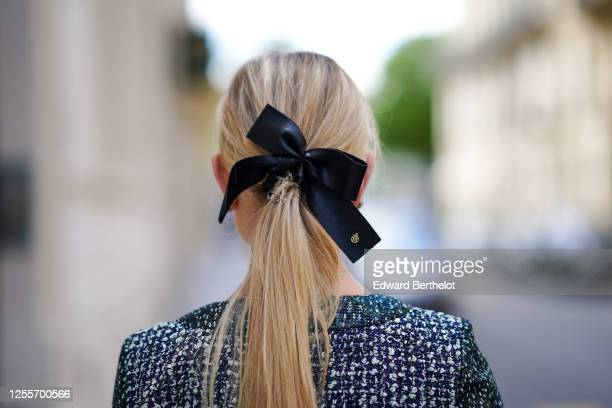 Lexi Fargo wears a Maison Michel hair bow / ribbon, a Chanel green and white tweed jacket, on July 11, 2020 in Paris, France.
