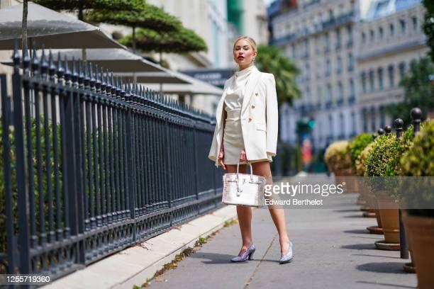 Lexi Fargo wears a white Zara oversized blazer jacket, a white Zara blouse, a Zara skirt, Chanel earrings, a brown and white Hermes Himalayan Birkin...
