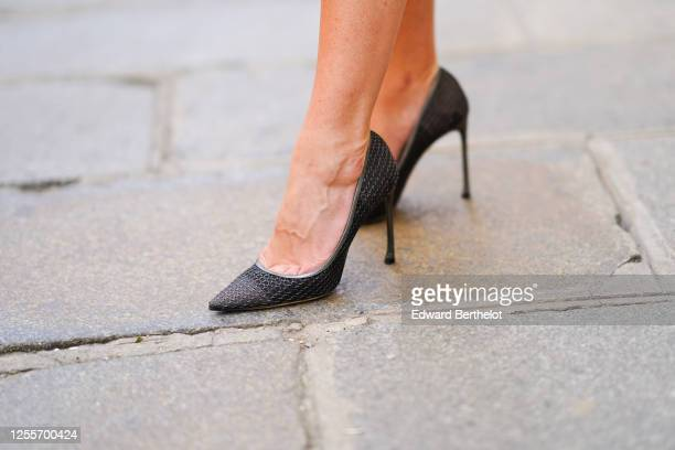 Lexi Fargo wears Dior gray and silver metallic mesh pointy high heeled shoes, on July 11, 2020 in Paris, France.