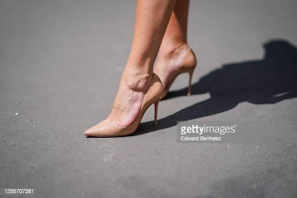 Lexi Fargo wears Louboutin beige high heeled pointy shoes on July 11 2020 in Paris France