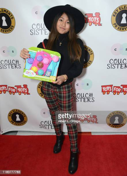 Lexi Hernandez attends The Couch Sisters 1st Annual Toys For Tots Toy Drive held onNovember 20 2019 in Glendale California
