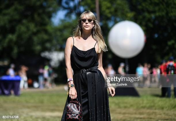 Lexi is seen wearing a Coach dress and YSL fringed leather skirt with Louis Vuitton bag during the 2017 Panorama Music Festival Day 3 at Randall's...