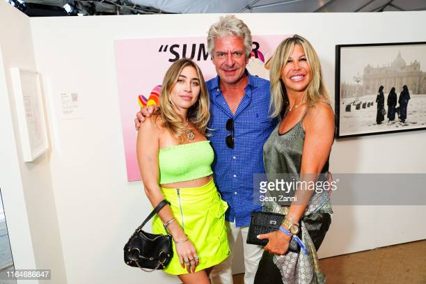 Lexi Kaplan Jeffrey A Smith and Amy Kaplan attend Tabula Rasa The 26th annual Watermill Center Benefit Auction at The Watermill Center on July 27...