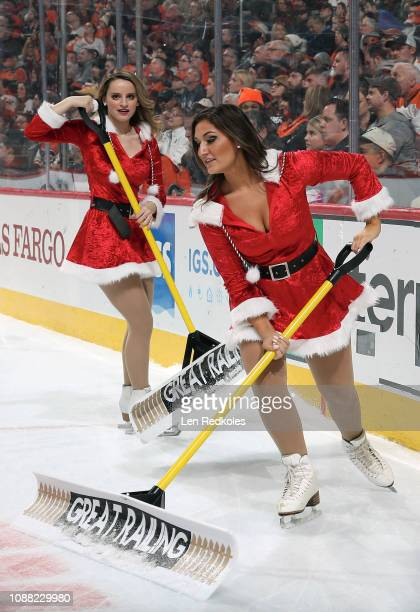 Lexi Lord and Maria Gentile of the Philadelphia Flyers ice girls clean the ice during a timeout against the Columbus Blue Jackets on December 22 2018...