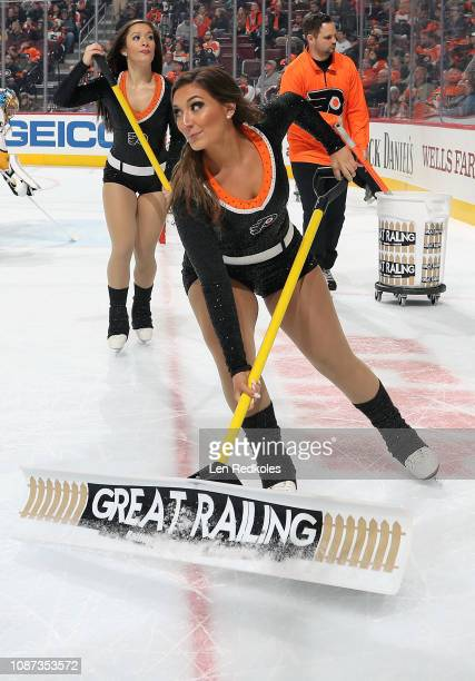 Lexi Lord of the Philadelphia Flyers ice girls cleans the ice during a timeout against the Nashville Predators on December 20 2018 at the Wells Fargo...