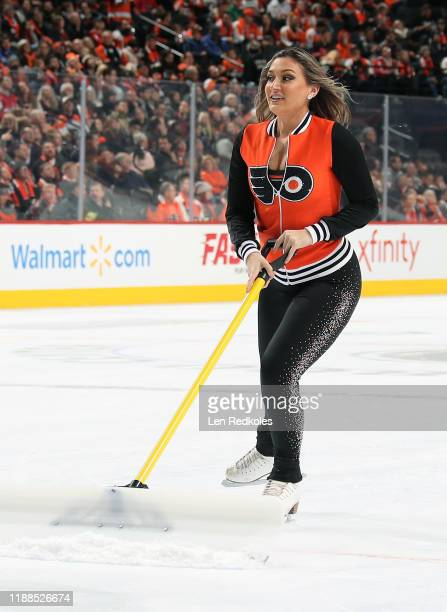 Lexi Lord of the Philadelphia Flyers ice girls cleans the ice during a timeout against the Washington Capitals on November 13 2019 at the Wells Fargo...