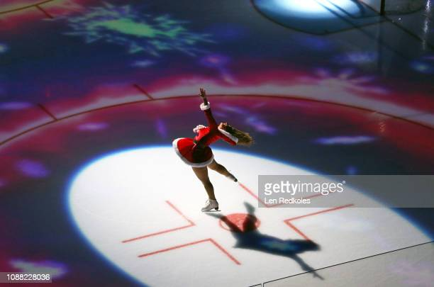 Lexi Lord of the Philadelphia Flyers ice girls skates during a pregame holiday light show prior to the start of an NHL game between the Philadelphia...