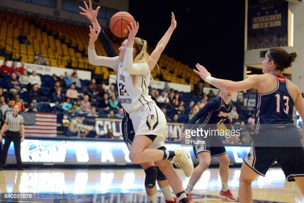 Lexi Martins of the George Washington Colonials drives to the hoop against the Duquesne Lady Dukes at Charles E Smith Athletic Center on January 29...