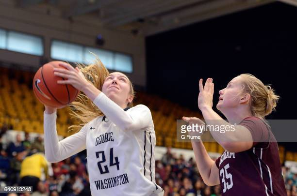 Lexi Martins of the George Washington Colonials drives to the hoop against the Fordham Lady Rams at Charles E Smith Athletic Center on February 1...