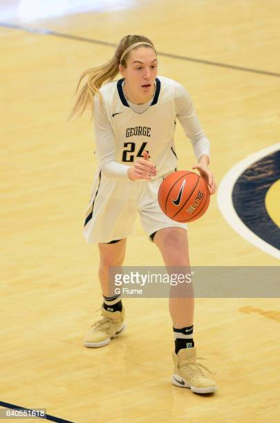Lexi Martins of the George Washington Colonials handles the ball against the Duquesne Lady Dukes at Charles E Smith Athletic Center on January 29...