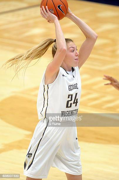 Lexi Martins of the George Washington Colonials passes the ball against the Virginia Commonwealth Lady Rams at Charles E Smith Athletic Center on...