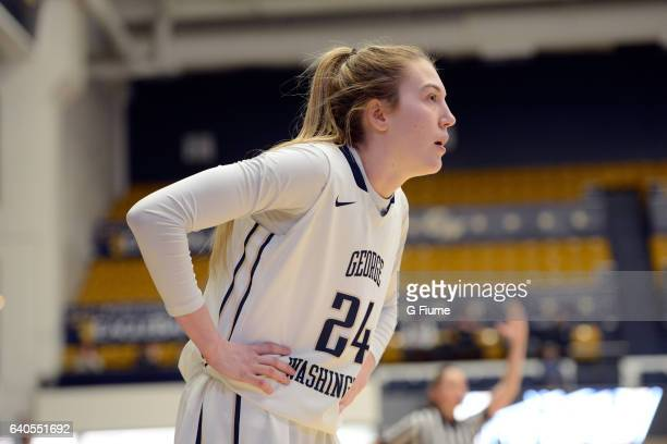 Lexi Martins of the George Washington Colonials rests during a break in the game against the Duquesne Lady Dukes at Charles E Smith Athletic Center...