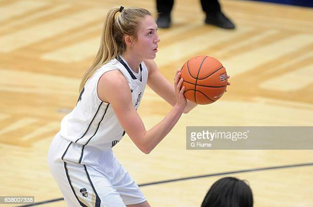 Lexi Martins of the George Washington Colonials shoots a free throw against the Virginia Commonwealth Lady Rams at Charles E Smith Athletic Center on...