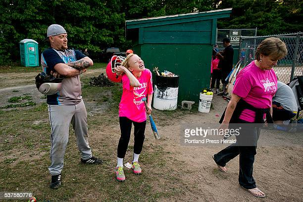 Lexi Nevells laughs as she takes off her batting helmet after grounding out in a Little League softball game in Hollis Wednesday June 1 2016 Nevells...