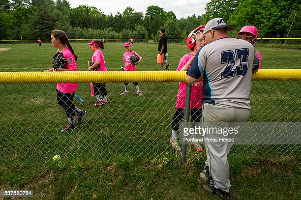 Lexi Nevells talks with her father Scott Nevells as she and her teammates prepare for a Little League softball game in Hollis Wednesday June 1 2016...