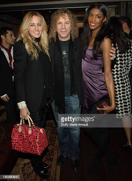 Lexi Quaas musician David Bryan of Bon Jovi and Victoria's Secret model Sessilee Lopez attend the Yellow Fever launch party at RdV on February 19...
