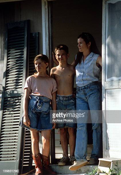 Lexi Randall Elijah Wood and Mare Winningham stand in the doorway in a scene from the film 'The War' 1994