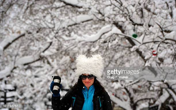 Lexi Ruskin heads to work on Broadway during Thursdays snowstorm in Boulder CO December 22 2011 She says she love the hat a friend made for her it so...
