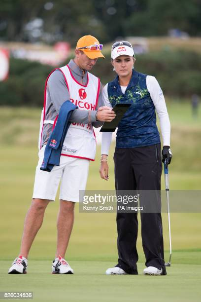 Lexi Thompson and her caddie on the green at the 15th hole during day one of the 2017 Ricoh Women's British Open at Kingsbarns Golf Links St Andrews