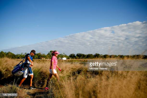 Lexi Thompson and her caddie walk to the 18th fairway during the third round of the LPGA CME Group Tour Championship at Tiburon Golf Club on November...