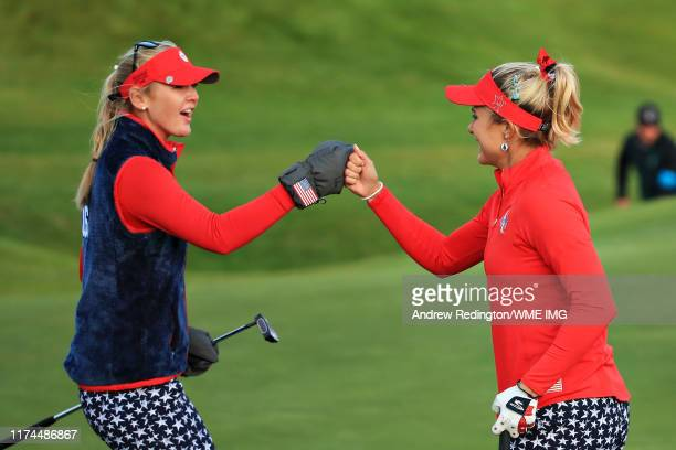 Lexi Thompson and Jessica Korda of Team USA celebrate after they halved the match on the eighteenth hole during Day 1 of The Solheim Cup at...
