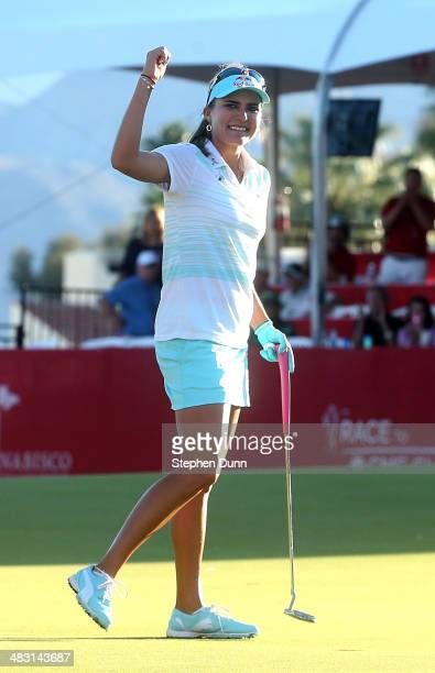 Lexi Thompson celebrates after making the final putt and winning the tournament during the final round of the Kraft Nabisco Championship at Mission...