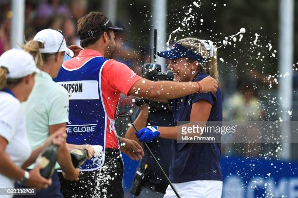 Lexi Thompson celebrates with her caddie and brother Curtis Thompson after winning the LPGA CME Group Tour Championship at Tiburon Golf Club on...