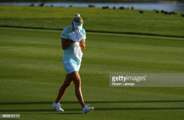 Lexi Thompson cries in a towel as she walks to the 18th green after her second shot during the final round of the ANA Inspiration on the Dinah Shore...