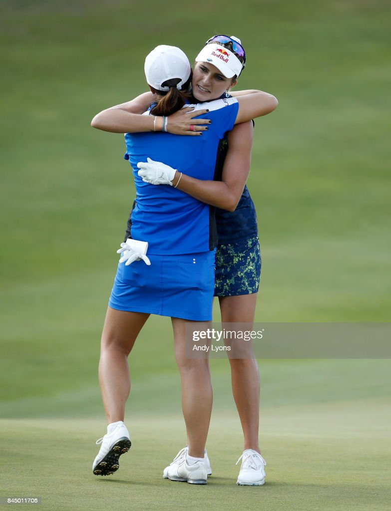 Lexi Thompson (right) hugs Candi Kung after winning the Indy Women In Tech Championship-Presented By Guggenheim at the Brickyard Crossing Golf Course on September 9, 2017 in Indianapolis, Indiana.