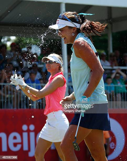 Lexi Thompson is showered with water by Jaye Marie Green with Kris Tamulis in the background after Thompson won the Meijer LPGA Classic presented by...