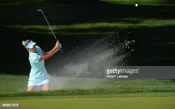 Lexi Thompson makes a shot out of a bunker on the 11th hole during the final round of the ANA Inspiration on the Dinah Shore Tournament Course at...