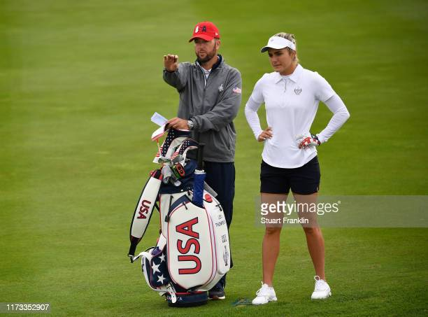 Lexi Thompson of Team USA and caddie ponder a shot during practice prior to the start of The Solheim Cup at Gleneagles on September 09, 2019 in...