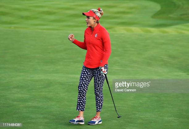 Lexi Thompson of Team USA reacts after her putt on the eighteenth green halved the match during Day 1 of The Solheim Cup at Gleneagles on September...
