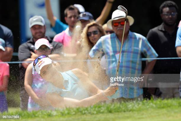 Lexi Thompson of the United States hits out of the bunker toward the 4th green during the first round of the Marathon LPGA Classic golf tournament at...