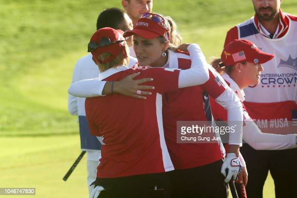 Lexi Thompson of the United States is congratulated by Misuzu Narita of Japan after her side's victory on the 15th hole in the Pool B match between...