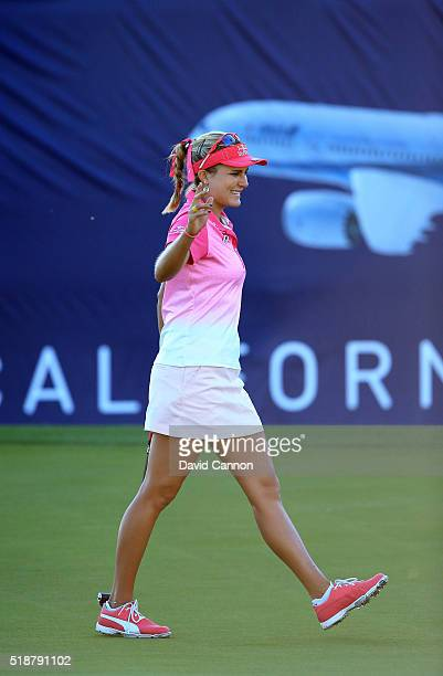 Lexi Thompson of the United States makes an eagle putt at the par 5 18th hole to finish 10 under par and leading the tournament by one shot during...