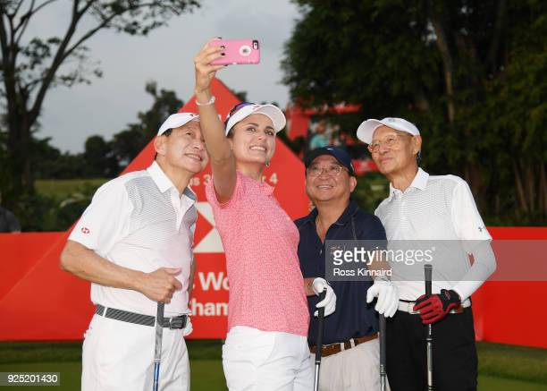 Lexi Thompson of the United States takes a selfie photo with her group during the proam prior to the HSBC Women's World Championship at Sentosa Golf...