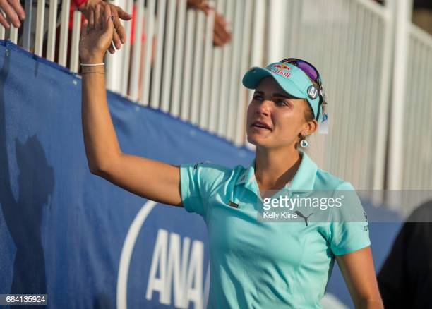 Lexi Thompson of the United States tearfully greets fans on the 18th hole during the final round of the 2017 ANA Inspiration at Mission Hills Country...