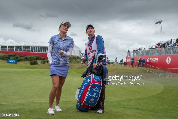 Lexi Thompson of the USA jokes with fans in the stand around the 18th hole as storm clouds start to gather again over the Kingsbarns links during day...