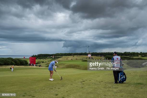 Lexi Thompson of the USA plays her approach into the 17th hole as storm clouds start to gather again over the Kingsbarns links during day two of the...
