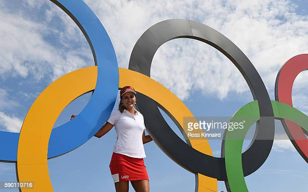 Lexi Thompson of the USA poses with the Olympic Rings during a practice round prior to the Women's Individual Stroke Play golf at the Olympic Golf...