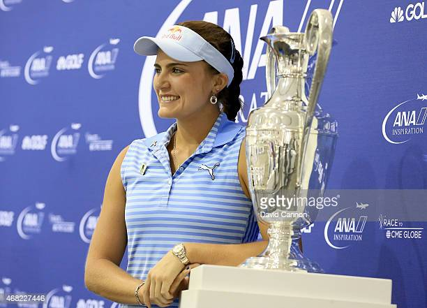 Lexi Thompson of the USA the defending champion poses with the ANA Inspiration torphy in her media conference as a preview for the ANA Inspiration on...
