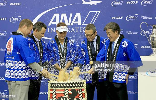 Lexi Thompson of the USA the defending champion takes part in a traditional Japanese 'Kagamibiraki' celebration where the lid of the Saki wooden...