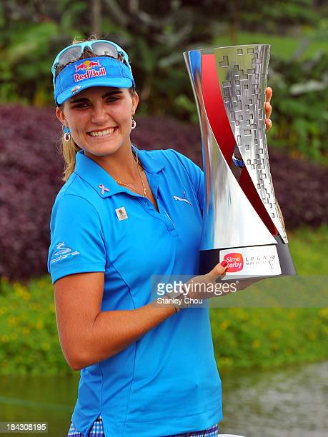 Lexi Thompson of USA poses with the Sime Darby LPGA Trophy after she won 19 under 265 during day four of the Sime Darby LPGA at Kuala Lumpur Golf...